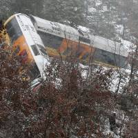 Boulder smashes French tourist train, killing 2