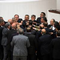 Turkey tightens control over judiciary as debate turns to brawl