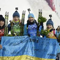 More than a game: The Ukrainian team celebrates after winning the gold medal in the women's biathlon 4x6-km relay on Friday. | AFP-JIJI