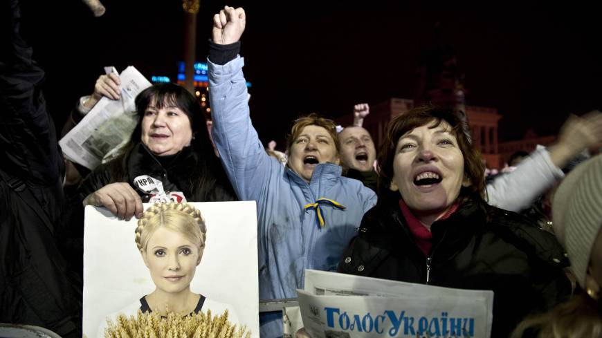 An opposition protester holds a picture of newly freed Ukrainian opposition leader Yulia Tymoshenko as the former prime minister delivers a speech at a rally in Kiev's Independence Square on Saturday.