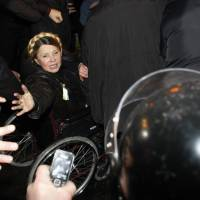 Newly freed Ukrainian opposition icon Yulia Tymoshenko greets people as she arrives to speak at Independence Square in Kiev on Saturday, moments after parliament voted to hold an early presidential election in May. | AFP-JIJI