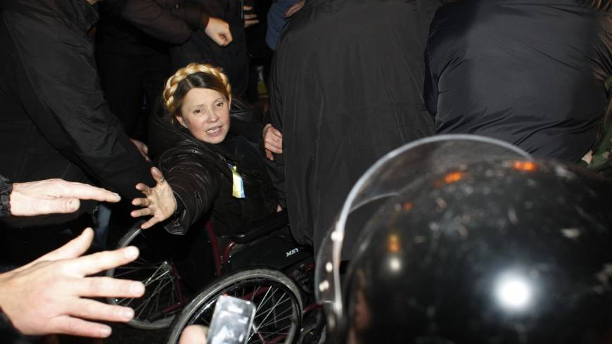 Newly freed Ukrainian opposition icon Yulia Tymoshenko greets people as she arrives to speak at Independence Square in Kiev on Saturday, moments after parliament voted to hold an early presidential election in May.
