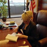 In this photo tweeted by the office of Arizona Gov. Jan Brewer, she vetoes Senate Bill 1062, a Republican bill that set off a national debate over gay rights, religion and discrimination and subjected Arizona to blistering criticism from major corporations and political leaders from both parties, on Wednesday in Phoenix. The caption that accompanied the photo on Twitter read, 'Moments ago, I vetoed #SB1062.' | AP