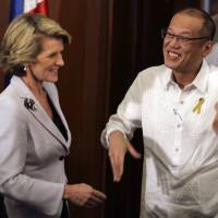 Philippine President Benigno Aquino III (right) greets Australian Foreign Minister Julie Bishop before their meeting at the Malacanang presidential palace in Manila on Thursday. | AP