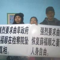 Protest crackdown: Three members of a spontaneous Citizens Watchers Group hold up placards Friday in Xuzhou, eastern China, demanding investigations into the suspicious death of an activist's father. | AP