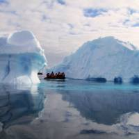 Out in the cold: Tourists on a boat pass huge icebergs in January 2010 on the Antarctic Peninsula. Over the weekend, China officially opened its fourth Antarctic research station — the flying saucer-shaped Taishan — , in another step for the country's exploration ambitions. | AFP-JIJI