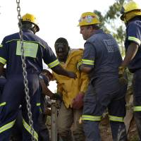 11 South African gold miners rescued, then arrested