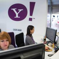 Employees work in the sales office at the Yahoo Inc. headquarters in Barcelona, Spain, on Thursday. | BLOOMBERG