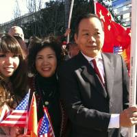 Proper welcome: Anna Wu, American businessman Vincent Wu (right) poses with his wife, Yip Lai Fong (center) and daughter Anna Wu as they wait to welcome China's then-Vice President Xi Jinping on his visit to Los Angeles on Feb. | 16, 2012.ANNA WU/AP