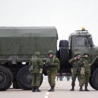 Ukraine accuses Russia of 'armed invasion' in Crimea