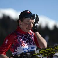 Emotional moment: Poland's Justyna Kowalczyk reacts at the finish line of the women's cross-country 10-km classic race at the Sochi Olympics on Thursday. Kowalczyk won the gold. | AFP-JIJI