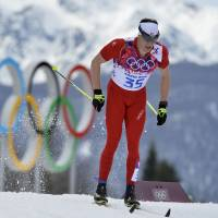 Cologna records impressive victory men's 15-km cross-country race