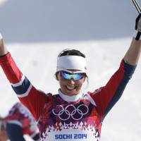 That winning feeling: Norway's Marit Bjoergen celebrates her victory in the women's 30K cross-country race in Krasnaya Polyana, Russia, on Saturday. | AP