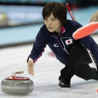 One purpose: Japan's Ayumi Ogasawara delivers the stone against Russia in a women's curling match on Wednesday in Sochi, Russia. | AP