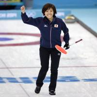 Still in the hunt: Japan skip Ayumi Ogasawara celebrates after her final throw helped her team beat China 8-5 at the Sochi Olympics on Monday. | AP