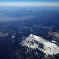 Just in case: Mount Fuji is seen Jan. 6. Shizuoka, Yamanashi and Kanagawa prefectures adopted the first comprehensive evacuation plan Thursday to prepare for its possible eruption. | BLOOMBERG