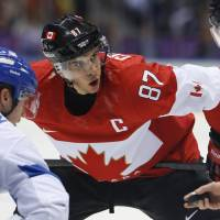 Quiet start: Canada's Sidney Crosby (87) has two assists in the defending Olympic champion's first three games in Sochi, Russia. | AP