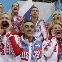 All in it together: Evgeni Plushenko (bottom left) was instrumental in Russia's success in the team skating event at the Sochi Olympics, which has proved popular with fans. | AP