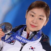 Not lashing out: Silver medalist Yuna Kim has not ripped the ice skating judges for giving the women's gold medal to Russian Adelina Sotnikova. | AFP-JIJI
