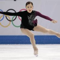 Poetry in motion: Yuna Kim landed six triple jumps in the free program and received 219.11 points in the two-day competition.  | AP