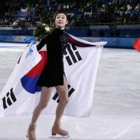 A show of class: Yuna Kim didn't criticize the judges' scores after she received the silver medal.   AP