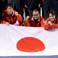 Reason to smile: Team captain Minoru Ueda (center) and players (from left) Yuichi Sugita, Go Soeda, Kei Nishikori and Yasutaka Uchiyama, share a happy moment after Japan's first-round victory over Canada in the Davis Cup on Sunday. | AFP-JIJI