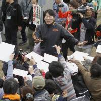 Man in demand: Former Yomiuri Giants and MLB star Hideki Matsui, back with Yomiuri as an invited coach during spring training, prepares to sign autographs for fans on Saturday in Miyazaki Prefecture. Spring training opened on Saturday for NPB's 12 teams. | KYODO
