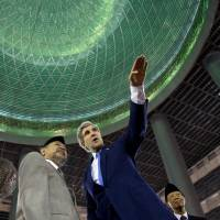 Immersed: U.S. Secretary of State John Kerry tours the Istiqlal Mosque with Grand Imam K.H. Ali Mustafa Yaqub on Sunday in Jakarta. The mosque, the largest in Southeast Asia and capable of holding 120,000 people, is designated as the National Mosque of Indonesia. | AP