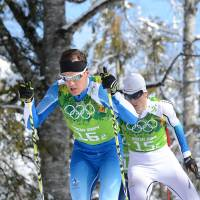 Singular focus: Finland's Sami Jauhojaervi (left) and Sweden's Teodor Peterson competes in the men's cross-country skiing team sprint classic at the Laura Cross-Country Ski and Biathlon Center near Sochi, Russia, on Wednesday. Finland won the gold. | AFP-JIJI