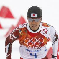 Moving along: Akito Watabe skis in the 10-km phase of the Nordic combined large hill competition on Tuesday. Watabe placed sixth overall, finishing 11.5 seconds behind gold medalist Joergen Graabak of Norway. | KYODO