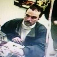 An image from a video surveillance camera released by the Michigan State Police shows escapee Michael David Elliot at an Indiana gas station late Sunday night. | AP