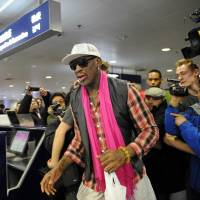 Second thoughts: Former NBA basketball player Dennis Rodman walks past the media to check in for his flight to North Korea at Beijing's international airport on Jan. 6. Rodman offered on Friday to take the place of an imprisoned U.S. missionary in North Korea, as he spoke publicly for the first time from a rehab facility. | AFP-JIJI