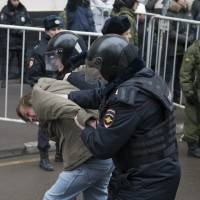Moscow court sends seven to prison for protest rally