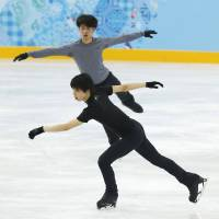 Getting ready: Olympians Tatsuki Machida (above) and Yuzuru Hanyu skate during a practice session on Tuesday in Sochi, Russia. | KYODO