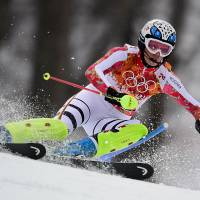 Hoefl-Riesch defends super-combined title
