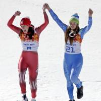 Shared glory: Women's downhill gold medal winners, Switzerland's Dominique Gisin (left) and Slovenia's Tina Maze stand on the podium together during an awards ceremony at the Sochi Olympics on  Wednesday. | AP