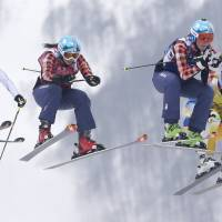 Aerial intensity: (From left) France's Ophelie David, from left, Canada's Kelsey Serwa, Canada's Marielle Thompson and Sweden's Anna Holmlund race during the women's ski-cross final in Krasnaya Polyana, Russia, on Friday. | AP