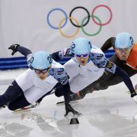 Fast is best: Russia's Viktor Ahn (left), Russia's Vladimir Grigorev (center) and Sjinkie Knegt of the Netherlands compete in the men's 1,000-meter short track speedskating final at the Iceberg Skating Palace on Saturday. | AP