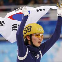 Unforgettable: South Korea's Shim Suk-hee jubilates after winning the women's 3000-meter short track speedskating relay final at the Iceberg Skating Palace on Tuesday. | AP