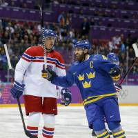 Big loss: Sweden captain Henrik Zetterberg (right) is out of the Olympics due to a back injury. | AP