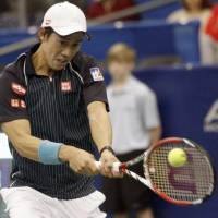 Singular focus: Kei Nishikori smacks a return to Russia's Alex Bogomolov in the U.S. National Indoor Championships on Friday in Memphis, Tennessee. Nishikori defeated Bogomolov 3-6, 6-3, 6-2. | KYODO