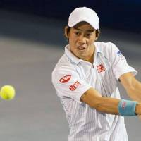Solid start: Kei Nishikori hits a return against Gastao Elias in the Delray Beach Open on Wednesday. Nishikori won 6-1, 5-7, 6-2. | KYODO