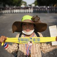 Thai court bans use of violence against protesters