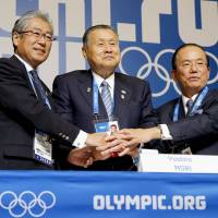 Providing perspective: Former Prime Minister Yoshiro Mori (center), the president of the Tokyo 2020 Olympic Games Organizing Committee, addressed the international media on Sunday in Sochi, Russia. In the photo, he is joined by Japanese Olympic Committee President Tsunekazu Takeda (left). | KYODO