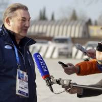 An icon: Vladislav Tretiak, a former goaltender for Russia's national ice hockey team, speaks with reporters at the Sochi International Airport on Monday. | AP