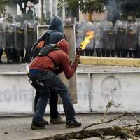 Venezuelan protesters dig in as death toll jumps