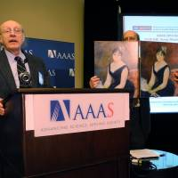 Rebirth of a masterpiece: Richard Van Duyne, professor of chemistry at Northwestern University, describes scientific techniques that revive the red hues in a Renoir painting at the American Association for the Advancement of Science meeeting in Chicago on Feb. 13. | AFP-JIJI