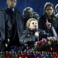 Ukrainian opposition leader Yulia Tymoshenko addresses anti-government protesters gathered in Kiev's Independence Square as her daughter Yevgenia (center right) and opposition leader Arseny Yatsenyuk (center left, with glasses) look on. | REUTERS