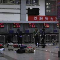 At least 27 dead, more than 100 injured in knife attack at China train station