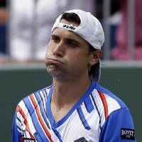 David Ferrer of Spain reacts after losing a point to Kei Nishikori at the Sony Open on Tuesday.  | AP
